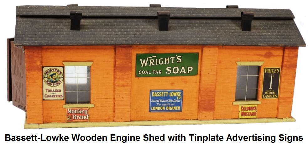 Bassett-Lowke wooden engine shed with tinplate advertising signs