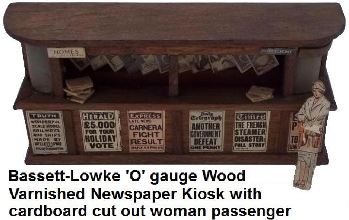 Bassett-Lowke 'O' gauge Wood Varnished Newspaper Kiosk with cardboard cut out woman passenger