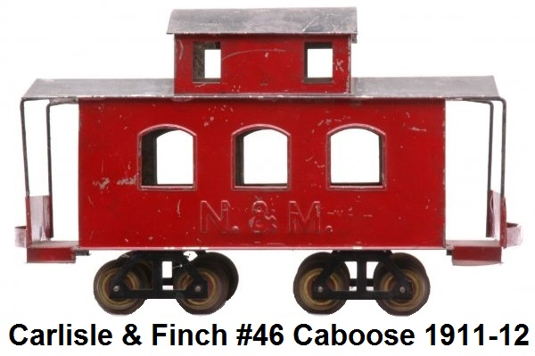 Carlisle & Finch #46 2 inch gauge small caboose with red enameled body, N&M embossed on sides, and black roof, circa 1911-1912