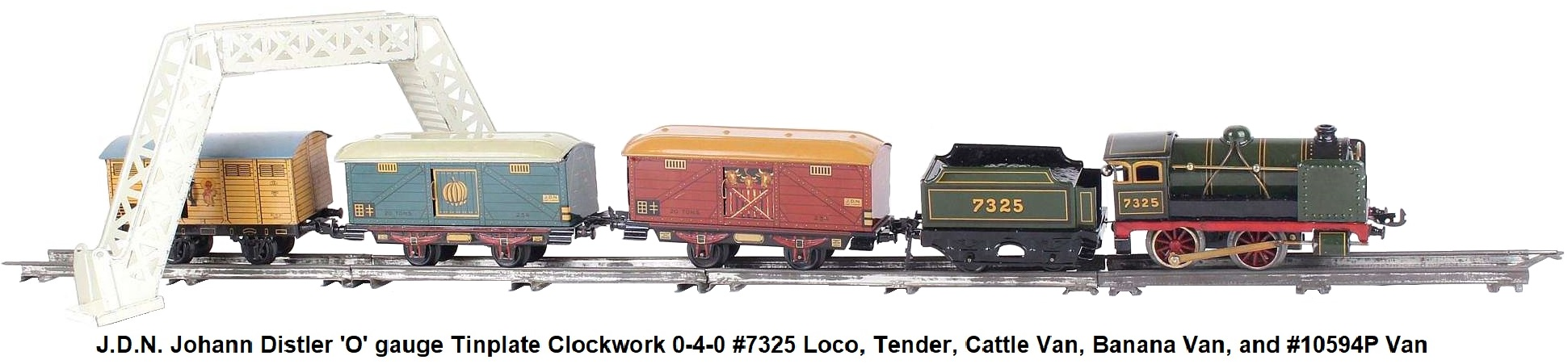J.D.N. Johann Distler 'O' gauge tinplate lithographed clockwork freight train set with #7325 steam outline locomotive and tender, two distinctive freight wagons, one with bananas, one with three cows, and a third wagon #10594P depicting a Mexican holding bananas