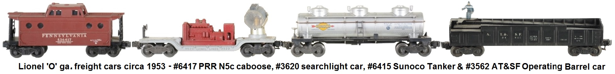 Lionel 'O' gauge freight cars circa 1953 with #6417 PRR N5c caboose, #3620 operating searchlight car, #6415 Sunoco tank car, and #2562-1 Operating Barrel Car