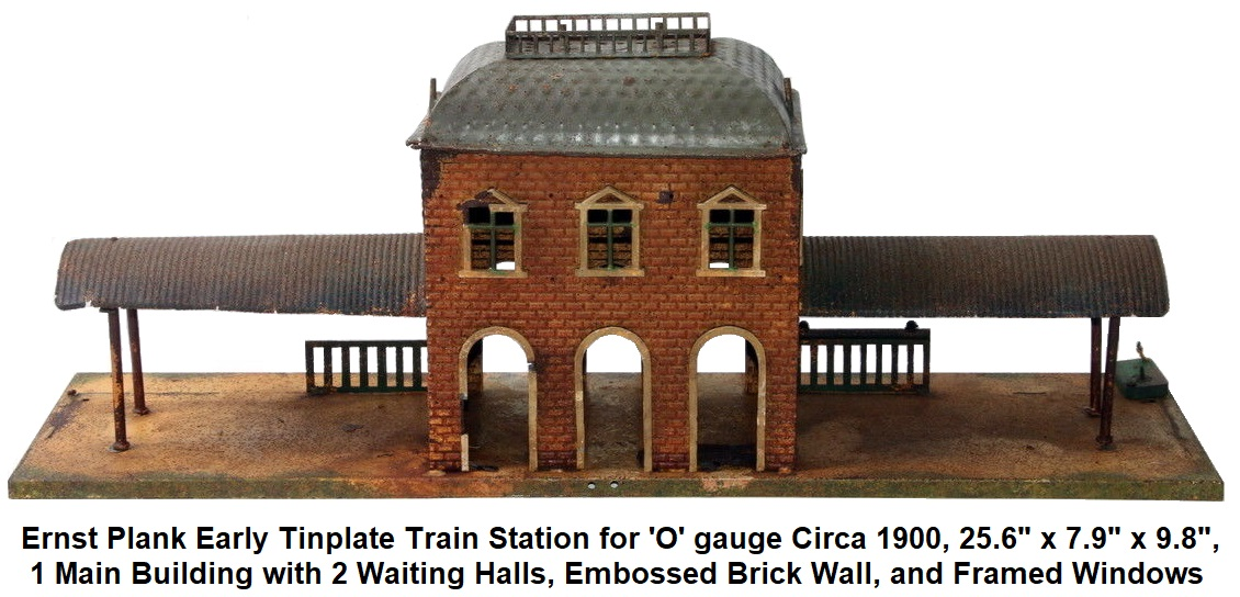 Ernst Plank Early Tinplate Train Station for gauge 'O' gauge circa 1900, 25.6 inches x 7.9 inches x 9.8 inches, 1 main building with 2 waiting halls, embossed brick wall, framed windows