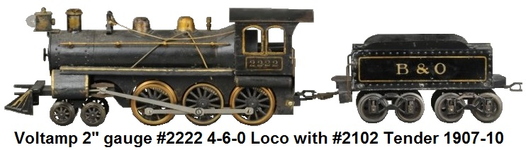Voltamp 2 inch gauge #2222 4-6-0 engine painted in black with gold highlights and lettering cast iron frame with integral motor and cab reverse unit #2102 tender in black with transfer gold graphics, sprung arch trucks made 1907-1910