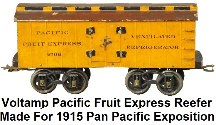Voltamp Hand painted tin baggage car, painted in orange body, red sides and brown roof, #6706 car is stamped Pacific Fruit Express on sides, floor made of wood. 12 inches long, made specifically for the 1915 Panama-Pacific exhibition in San Francisco